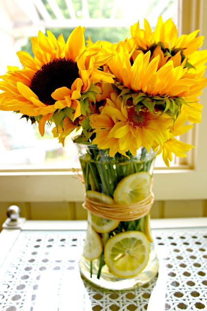 sunflowers and lemons in vase