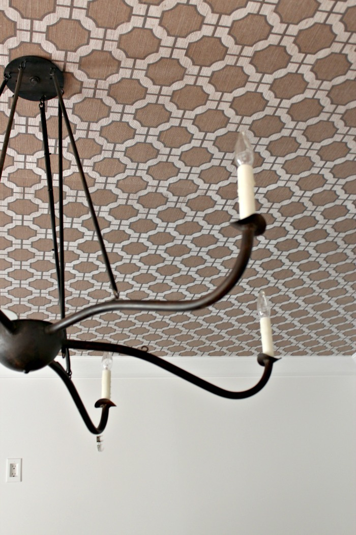 ... room ceiling is wallpapered with this gray trellis pattern which I think is a timeless choice. The paper is Phillip Jeffries Imperial Gates wallpaper.